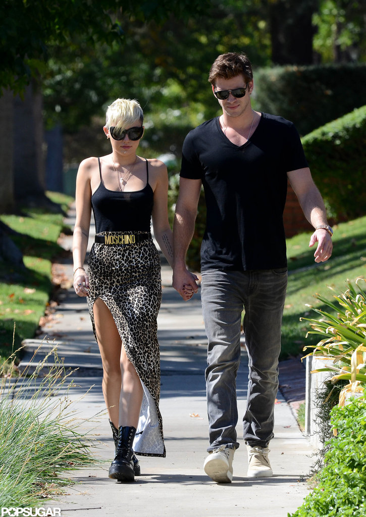 Miley Cyrus wore a maxi skirt with a high slit.
