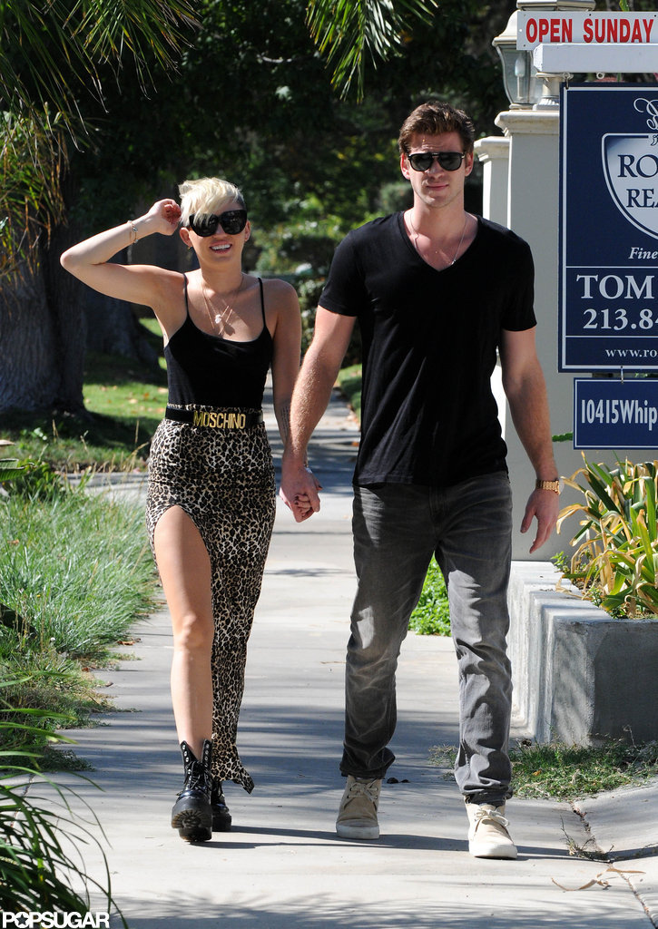Miley Cyrus and Liam Hemsworth smiled for the cameras.
