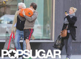 Claire Danes captured a photo of Hugh Dancy carrying pumpkins in Toronto.