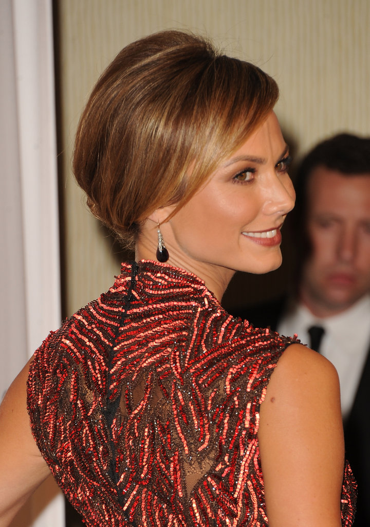 Stacy opted for a more mature swept-back bun for the occasion — but again, how amazing is the bead work on this gown?