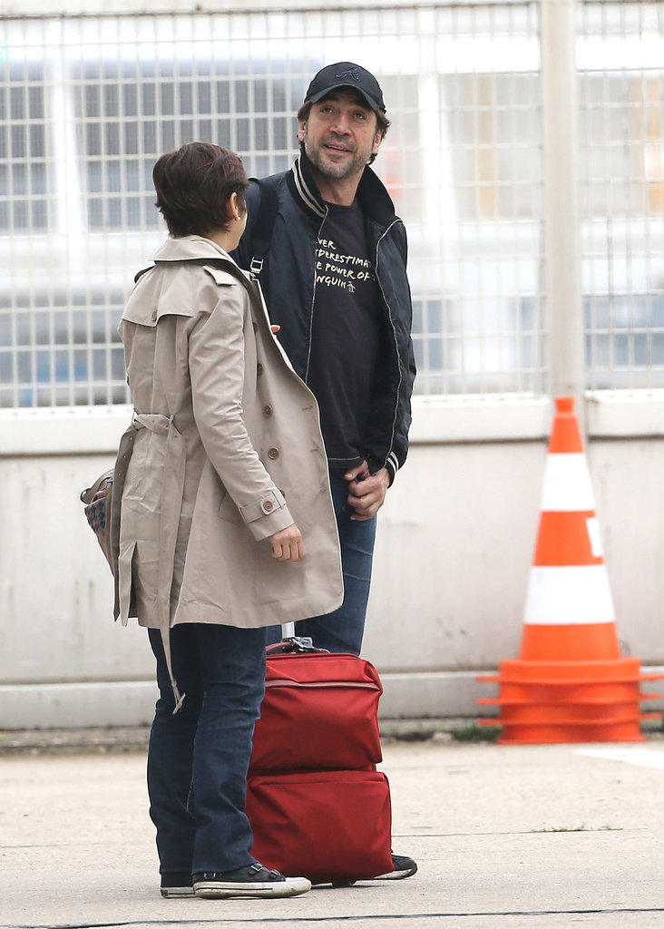 Javier Bardem chatted with a friend at the airport.