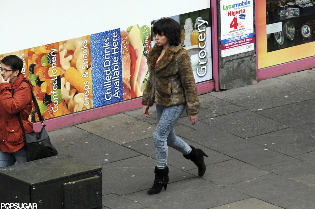 Scarlett Johansson popped up in Scotland wearing a brunette wig.