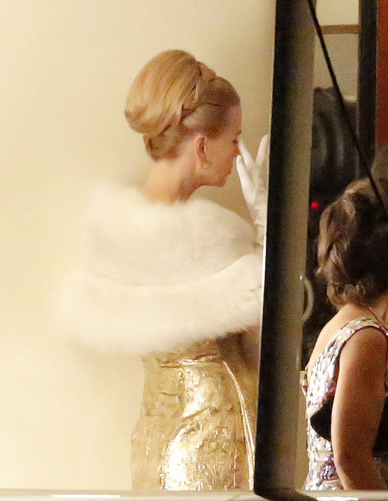 Nicole Kidman donned a gold gown and her hair in a bun.