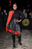 Jennifer Hudson opted for a high-impact color contrast, adding a bright orange coat to her all-black ensemble.