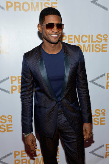 Usher posed for photos on the red carpet.