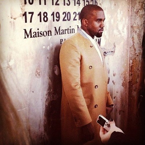 Kanye West arrived in an overcoat from the Maison Martin Margiela and H&M collection to celebrate the line's launch.