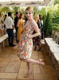 Emma Roberts kicked up her heels in a Stella McCartney Resort '13 floral strapless.