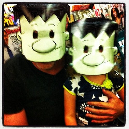Angela Kinsey's husband, Warren Lieberstein, and daughter Isabel wore funny masks.  Source: Instagram user angelakinsey