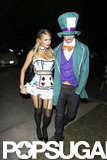 Paris Hilton and her Mad Hatter boyfriend River Viiperi channeled Alice in Wonderland at a party in LA on Friday.