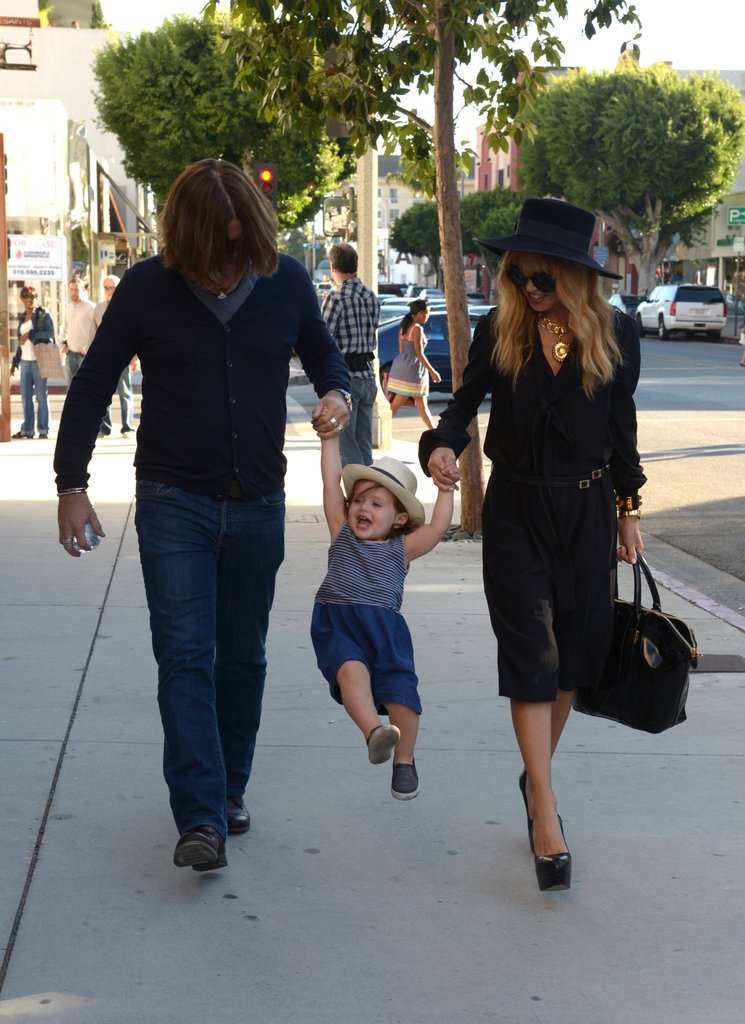 Rachel Zoe and Rodger Berman swung Skyler along.