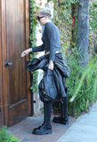 Miley Cyrus carried a purse and jacket in Burbank.