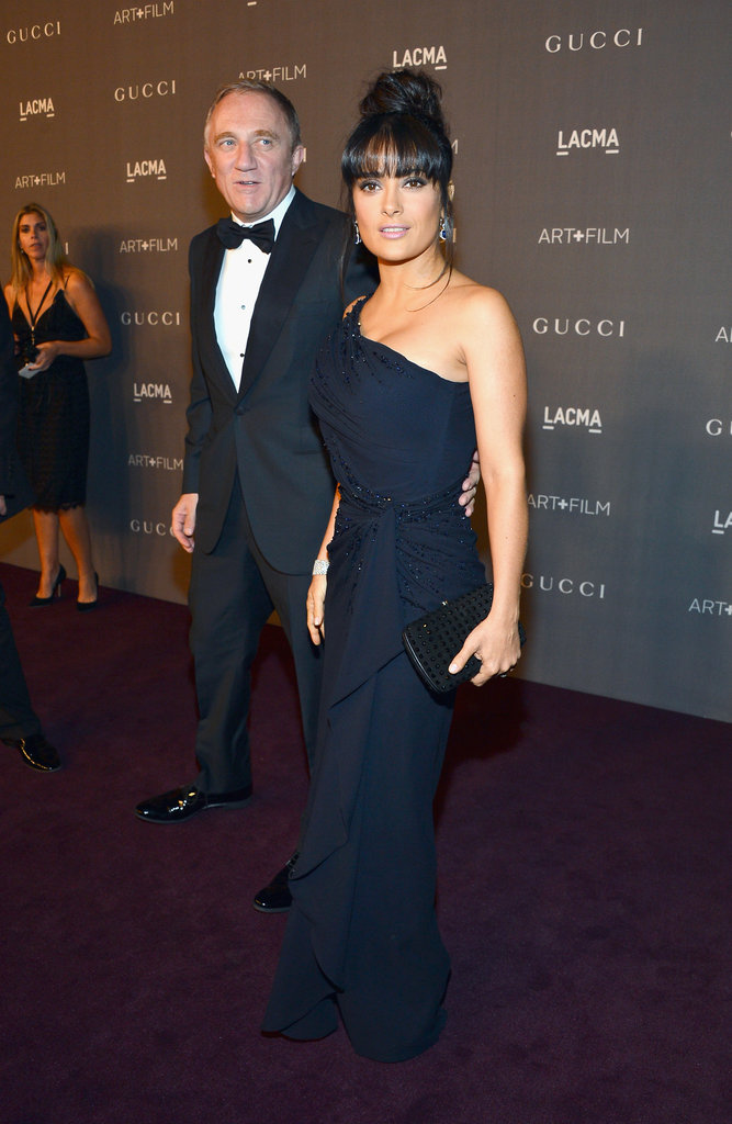 Salma Hayek made an elegant arrival in a one-shouldered gown with subtle sparkle.