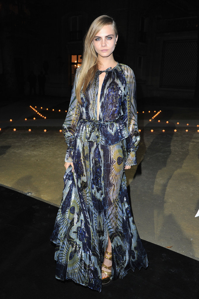Cara Delevingne stopped by Carine Roitfeld's Paris Fashion Week fete in a floor-length Emilio Pucci printed gown.