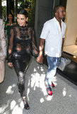 Kim Kardashian held hands with her boyfriend, Kanye West.