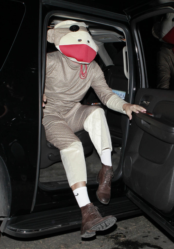 Sacha Baron Cohen hopped out of a car to attend a Halloween party dressed as a monkey in 2012.