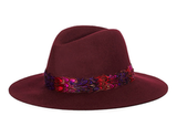Pair this Juicy Couture Floppy Fedora With Feathers ($78) with a dark floral-print maxi skirt, nubby oversize sweater, and boots for a decidedly '70s look.
