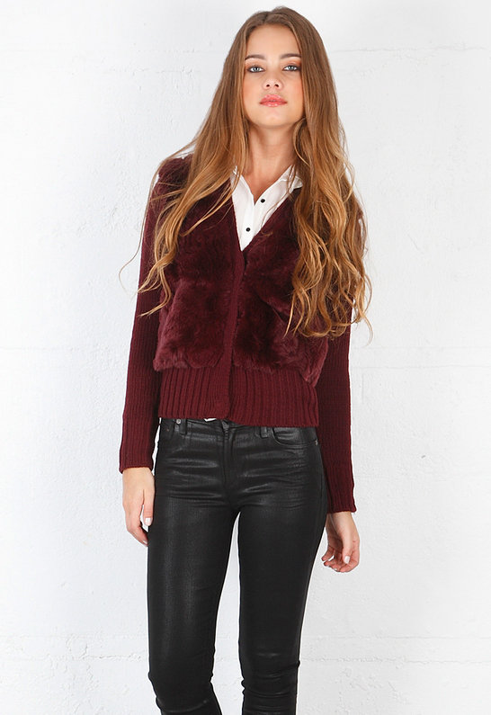 We love the fur paneling and deep red hue on this Elizabeth and James cardigan sweater ($565).