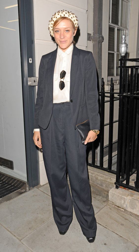 Chloe Sevigny topped off a borrowed-from-the-boys pantsuit with a much girlier (read: embellished) beanie.