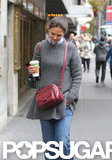 Katie Holmes carried a coffee.
