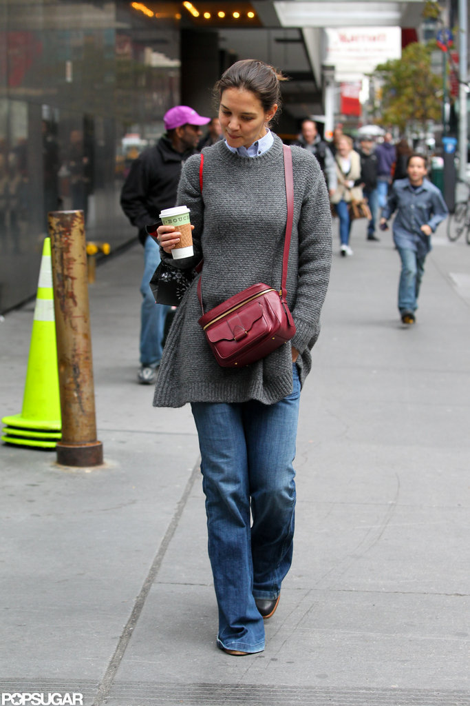 Katie Holmes kept warm in a long sweater.