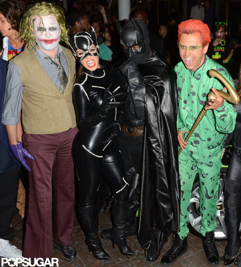 In Miami on Wednesday, Kim Kardashian and Kanye West posed as Catwoman and Batman with Jonathan Cheban as the Joker.