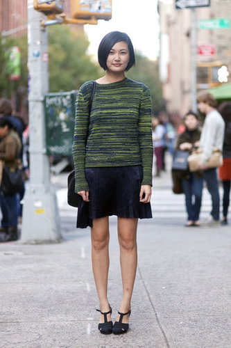 A cool-girl knit upped the ante on a pleated skirt and ladylike heels. Source: Adam Katz Sinding