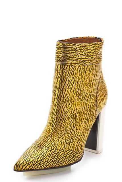 I'm not one to wear metallics but I can't seem seem to resist these Phillip Lim Peggy Boots ($725). The crackle gold makes the perfect statement piece without going over the top and while it might not be conducive to walking in puddles, I love the modern white heel.  — Chi Diem Chau, associate editor