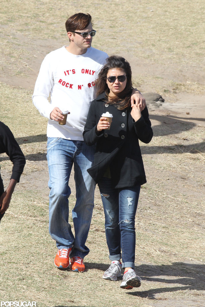 Mila Kunis walked with her boyfriend Ashton Kutcher in Sydney.