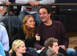 Mary-Kate Olsen and Olivier Sarkozy laughed together in the stands.