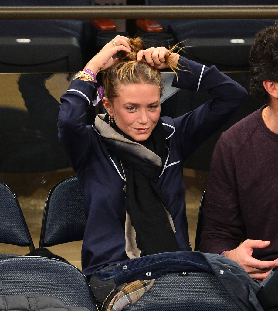 Mary-Kate Olsen fixed her hair in the stands.