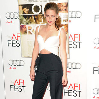 Kristen Stewart Wearing White Crop Top and Black Pants