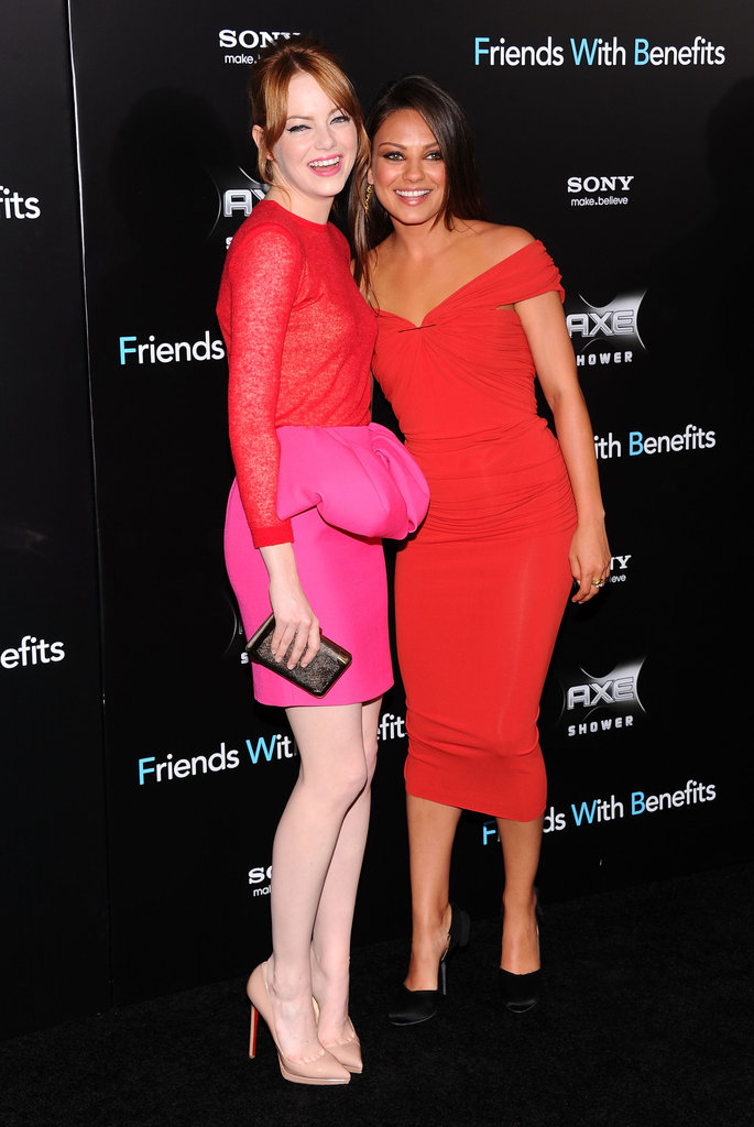 Emma Stone coordinated on the red carpet with Mila Kunis at the Friends With Benefits premiere in July 2011.