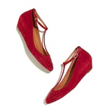 """Something about the gold studding and vibrant red suede finish gives us the feeling that these Madewell T-Strap mini wedges ($148) are a standout shoe for getting the """"red"""" part of your patriotic equation covered."""