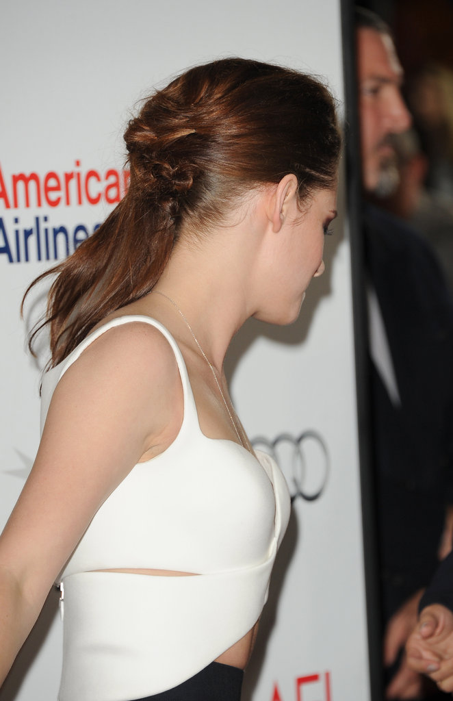 Kristen contrasted her modern, high-fashion bustier with a romantic look for her hair.