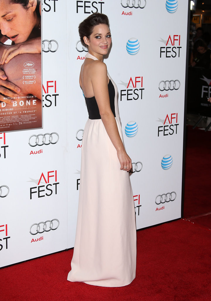 Marion Cotillard showed off the back of her halter dress.