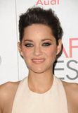 Marion Cotillard styled her hair in an updo for the event.