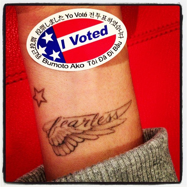 "Ashley Tisdale displayed her ""I Voted"" pin above her ""fearless"" tattoo on her wrist. Source: Instagram user ashleytis"