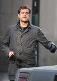Joshua Jackson stayed bundled up on set.