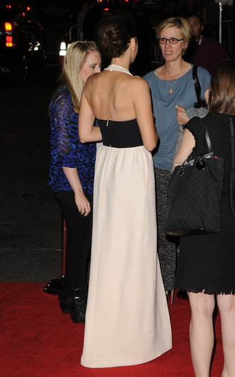 The rear view of Marion's look shows off her toned back.