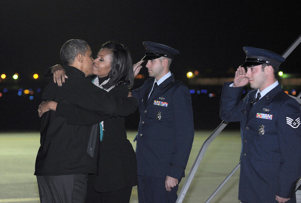 Obama went in for a kiss before boarding Air Force One.