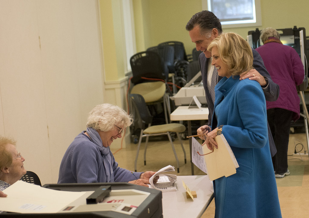 Mitt put his arm around Ann before placing his vote.