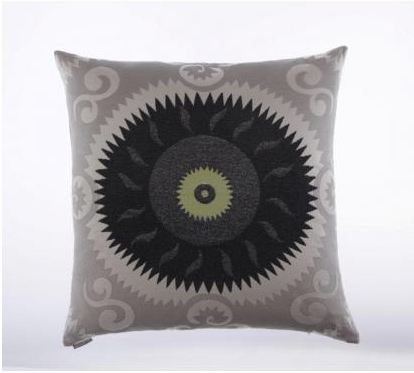 The cool charcoal and gunmetal gray tones in this Dark Sun Pillow ($93) put a fresh spin on suzani.