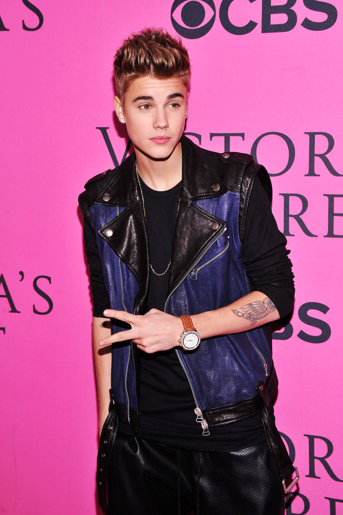 Justin Bieber posed for photos on the pink carpet at the Victoria's Secret Fashion Show after party in NYC.