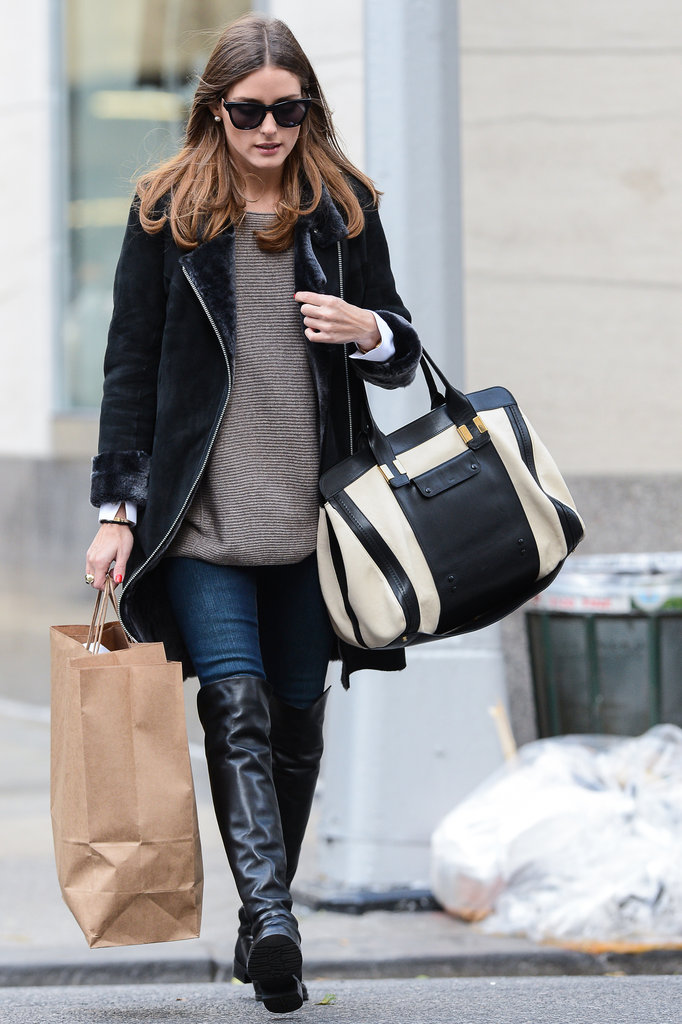 Olivia Palermo showed off some chic Fall layers and a pair of posh over-the-knee boots while strolling through NYC's Upper East Side.