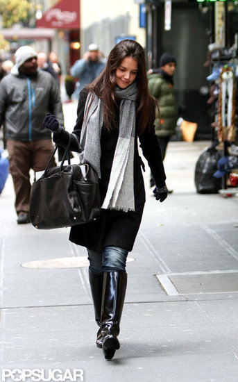 Katie Holmes wore knee high boots for a walk in NYC.