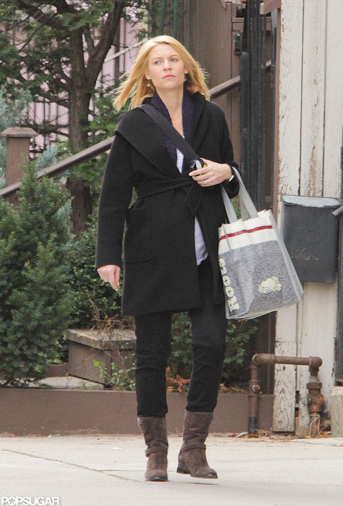 Claire Danes kept warm in a black coat.