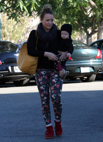 Hilary Duff put a hat on baby Luca Comrie for a trip to the market in LA.