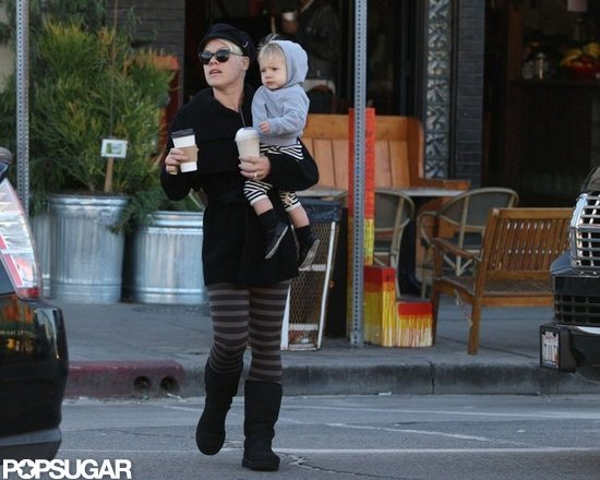 Pink carried Willow Hart and two coffees in Venice Beach.
