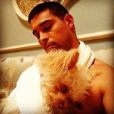 Wilmer Valderrama snuggled up with his dog. Source: Instagram user wilmervalderrama