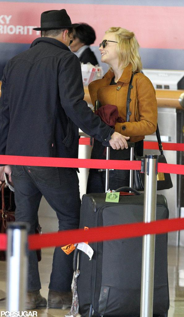 Carey Mulligan and Marcus Mumford waited in LA at LAX.